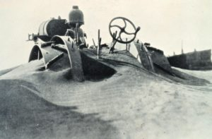 Buried farm equipment during the Dust Bowl.